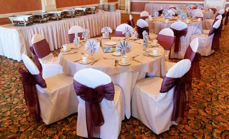 Black and Ivory Chair Covers available for rent with Wine Burgundy Organza bows in Manhattan Beach