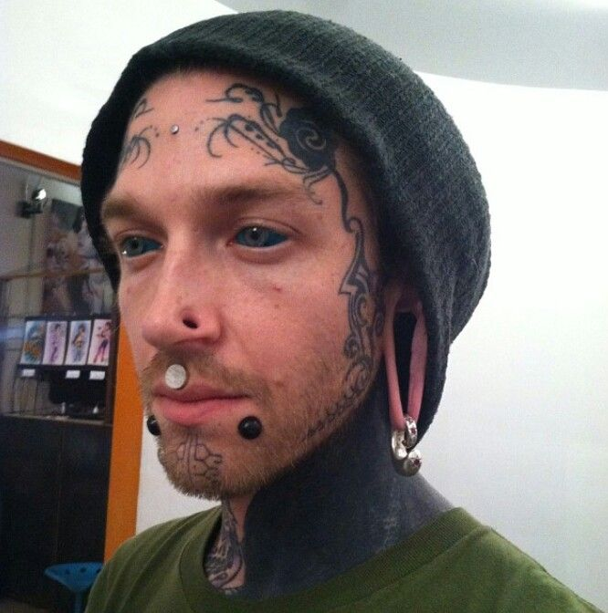 Matthew Blake showing off his new tattooed scleras and other modified bits. Stretched labrets, stretched philtrum, stretched nostrils, ear weights in his stretched lobes, a surface anchor, and some facial tattoos. // instagram@matthewblake //