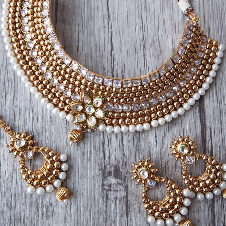 Getting married or attending a wedding? Check out this Dazzling Choker set decked in beautiful Kundan stones and pearls, statement worthy and classic !!! This can be paired up with one our long chain necklace to create a magnificent bridal ensemble. ✨  Visit us at www.aavarna.com Like us on FB: Aavarna  #bridesmaid #indianwedding #wedding #jewelry #bollywood #indianfashion #shaadi #indianbride #hindubride #earrings #forsale #templejewellery #indianfashion #jhumka #fashion #designinspiration…