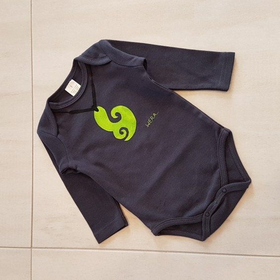 New onsie design. Maori design of a whales tale 'Wera'.  Stands for family love, playfulness, harmony and friendship.