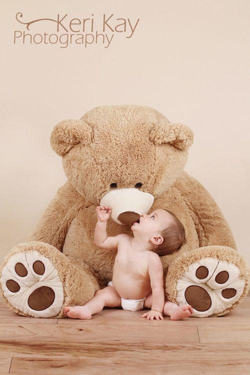 Baby  with a giant teddy bear. Adorable!