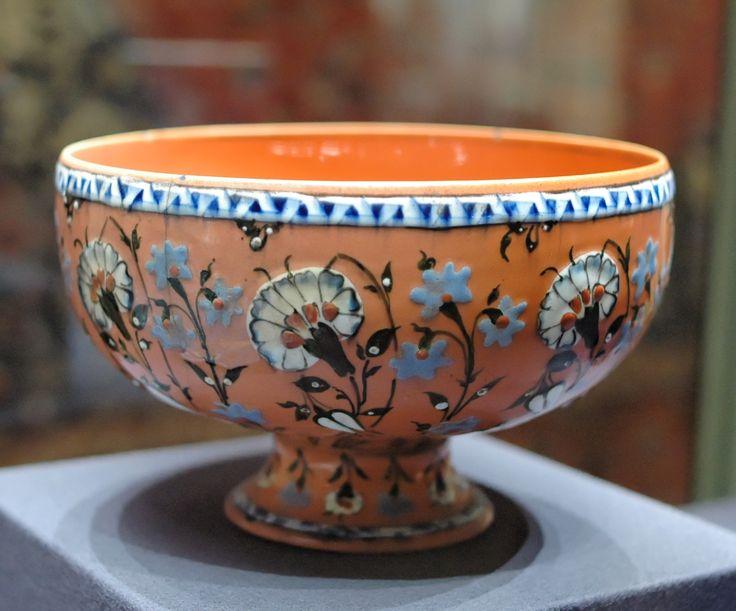 Cup with carnations. Slipped earthenware, transparent glaze, painted underglaze on slip. Turkey: Iznik, second half of the 16th century.