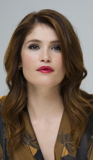 Gemma Arterton models a bewitching bustle dress that ADDS inches to her figure