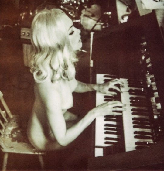 Naked Woman Playing Keyboard