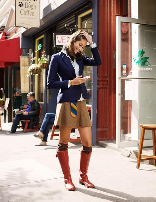Shop this look for $440:  http://lookastic.com/women/looks/blazer-and-tie-and-mini-skirt-and-knee-high-boots-and-dress-shirt/462  — Navy Blazer  — Multi colored Tie  — Tobacco Mini Skirt  — Red Leather Knee High Boots  — White Dress Shirt