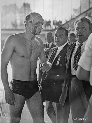 Hungarian water polo player Ervin Zador leaves the water covered in blood at the Melbourne Olympics, after the vicious match against Russia that came just days after Soviet tanks crushed a rebellion in his country. Picture: Supplied