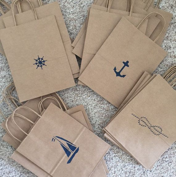 This listing is for a set of Kraft paper bags hand stenciled with assorted…