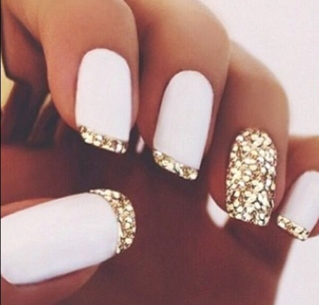 A bit much? I love it either way! White nails with gold tip.