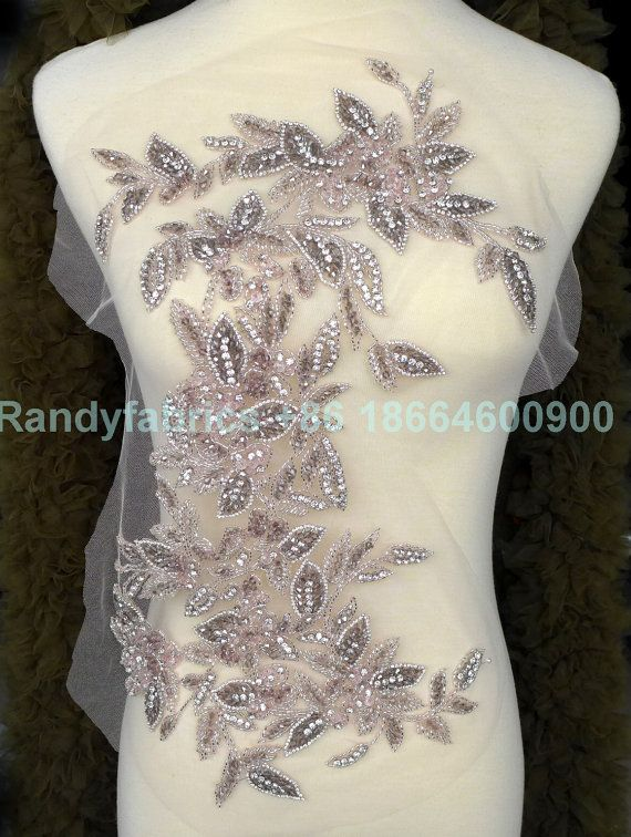 Price: The price is for 1 piece We also accept wholesale, start 15 pieces, if you want wholesale, contact us free.  Material: Rhinestones,pearls,mesh  Size : 48X26 cm  color:Silver with pink, the first picture, silver with white, the second picture.  Shipping: shipping by China post air mail;if you need ship by other way,just contact me.  Use for Dress,clothing and some others  Rim: Two sides are Flower shape