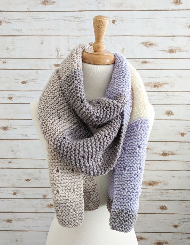 The Star Dust Knitted Garter Stitch Scarf is made with Caron Baby Cakes - a self-striping yarn so no need to change colors or weave in extra ends!