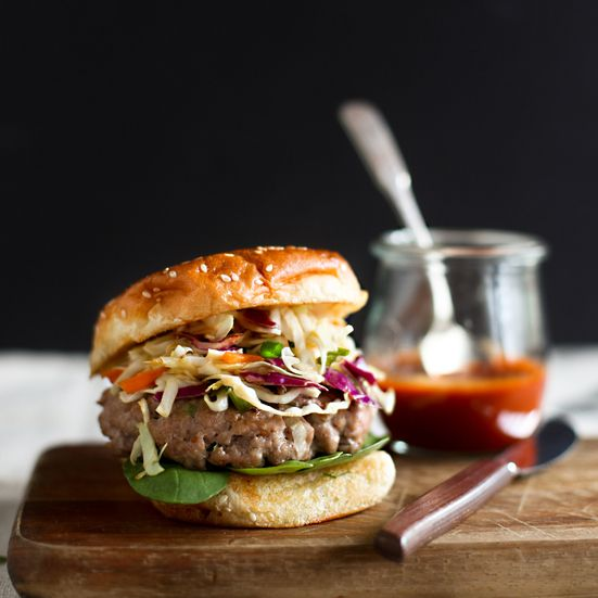 F&W's Melissa Rubel adds scallions, fresh ginger, garlic and sesame oil to ground pork for a juicy Asian-flavored burger.    All-Time Favorite...