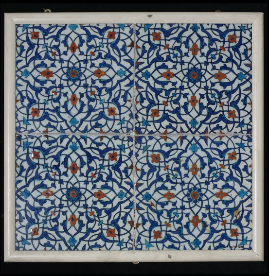 Tile panel | Made in Iznik, Turkey, ca. 1570 | Materials: fritware, polychrome underglaze painted, glazed | In the Middle East, tilework was originally developed as a decorative cladding for brick structures. After 1400 its use spread to Turkey, where tiles were applied to stone buildings using mortar | The most accomplished type had colourful designs painted on a brilliant white ground. Tiles from the Turkish city of Iznik soon became very popular | VA Museum, London