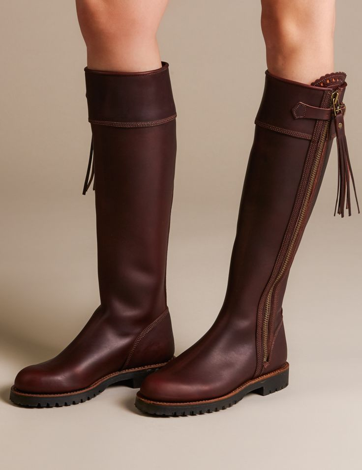 The original Penelope Chilvers Long Tassel Boot in Spanish vegetable-dyed leather. This handmade boot is cut close to the ankle for a more feminine fit, has a scalloped detail at the zip panel and a leather tassel on the zip pull. It is fully leather lined and has a Goodyear Welted Commando rubber sole. Perfectly styled for long slim legs, our Long Tassel Boots (as worn by the Duchess of Cambridge) encase the leg beautifully giving a sleek elegant silhouette.  (CALF MEASUREMENTS…