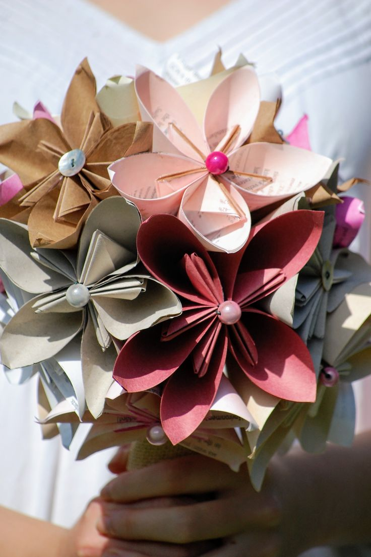 paper floristry -  So you are looking for a origami bridal bouquet?  You can have:  Fine or upcycling paper Vibrant or more sophisticated colours Plain or a mix of plain and patterned paper Round bouquet or more natural Formal or funky Soon, we will upload the flowers and embellishment available – It will be all fun!