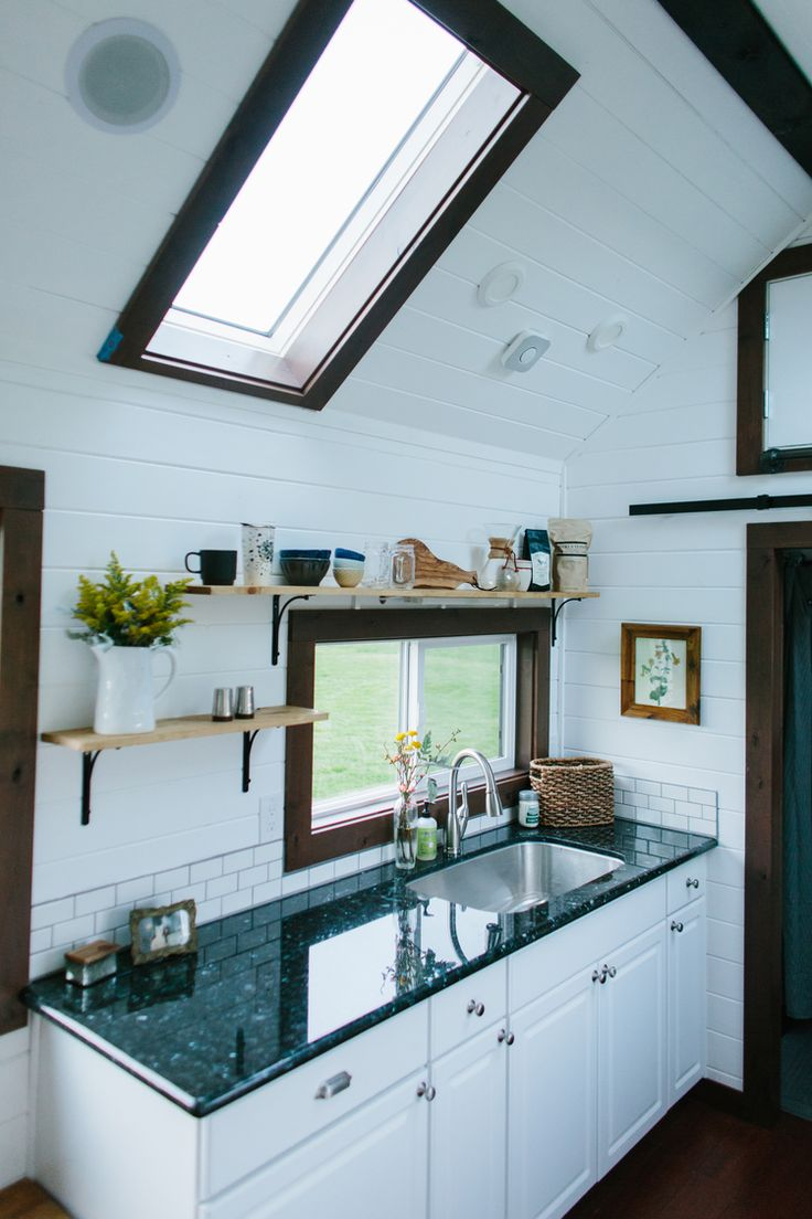 Love the skylights, window above sink. Would probably prefer quartz over granite countertops. Whats cheaper?