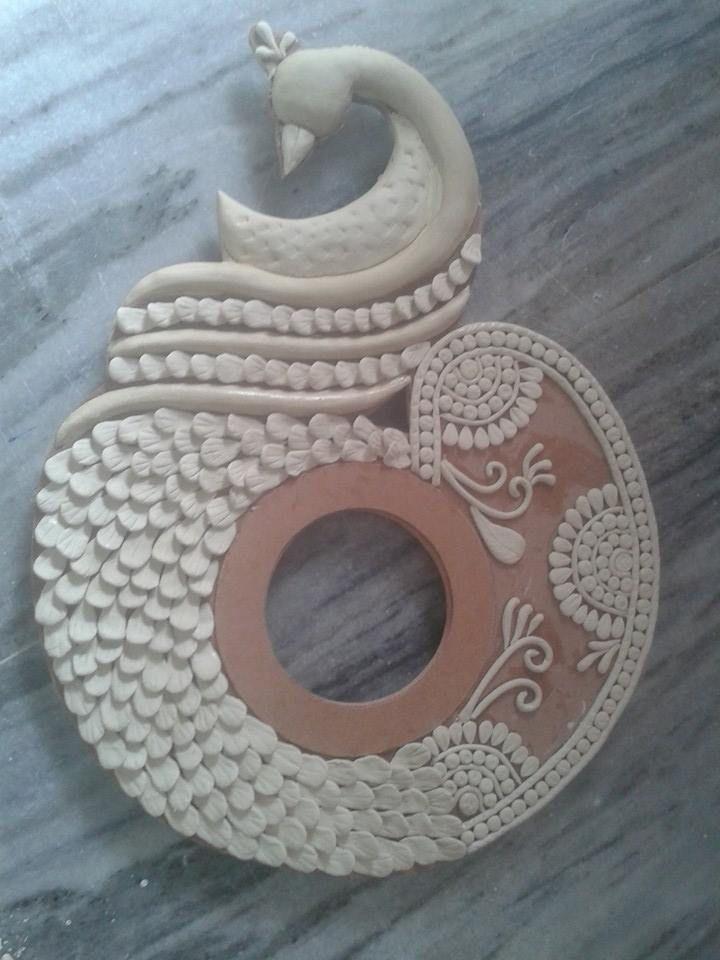Procedure of making peacock wall clock2023