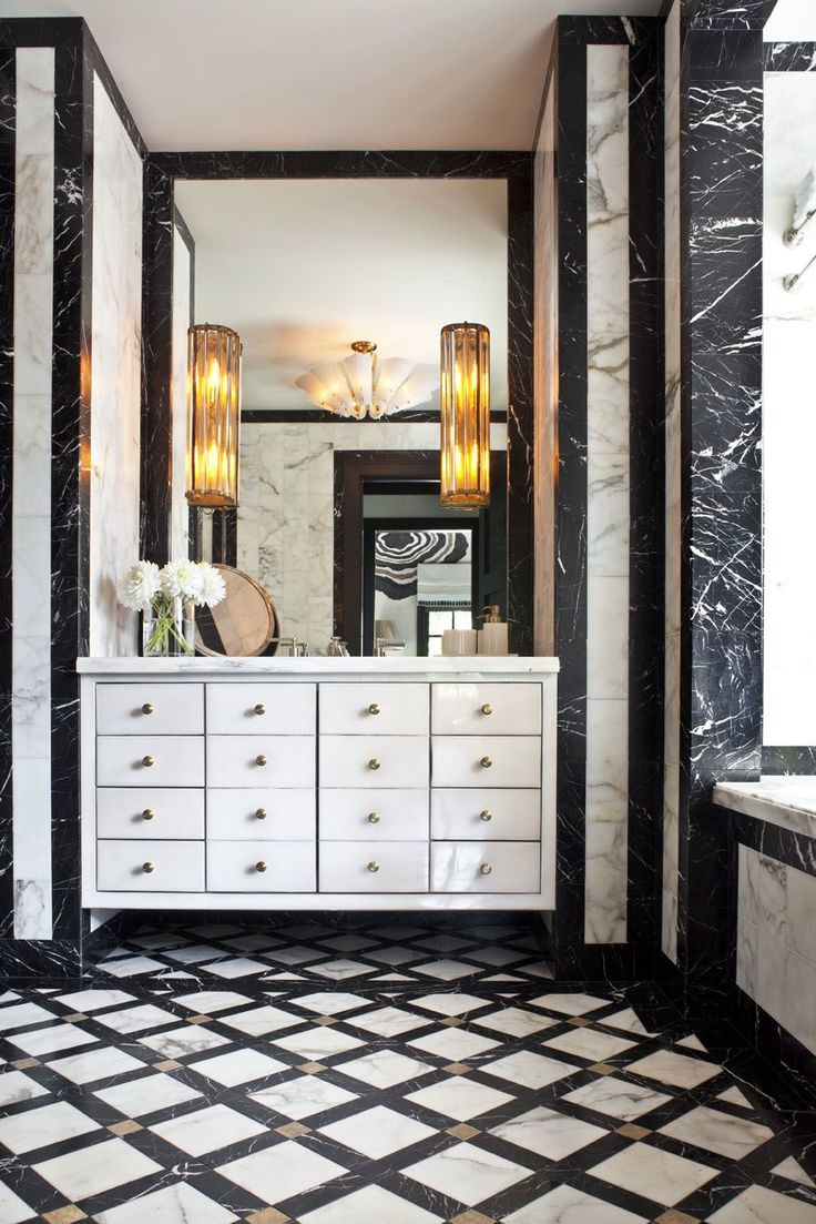 Powder Room - Exquisite craftsmanship using the finest of marble materials. Cleverly conceived - stunning.