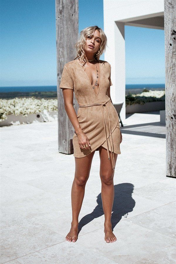 The super flattering Tan Oriana Dress is made from a faux suede fabric in a tan hue. It features a deep V neckline, short sleeves, an asymmetric hemline and super long attached waist wraps. Pair with gold layered necklaces and black heels for your next night out! By Sabo Skirt.