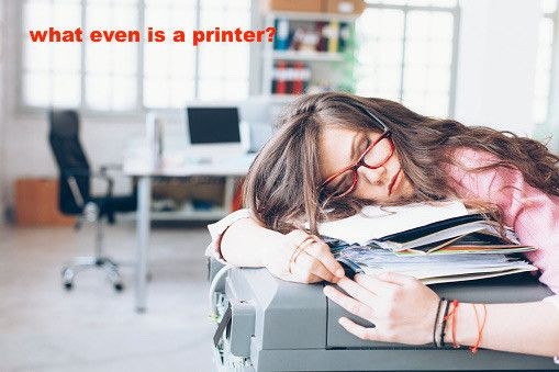 Tired and exhausted young woman sleeping on printer in the office. 18 Stock Image People You'll Relate To If You're Falling Asleep At Work