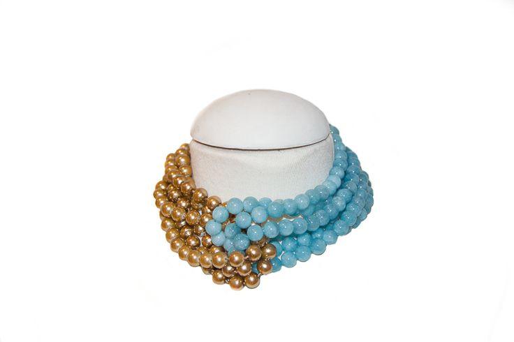 Perla de cristal dorada con ágatas turquesa