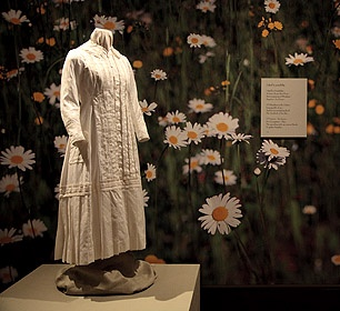 Emily Dickinson's Life Explored in the Library Gallery: Reproduction of Emily Dickinson's white dress circa 1878-82, Emily Dickinson Museum Collection Original, Amherst History Museum collection.  An exhibition of more than fifty fascinating objects — books, manuscripts, watercolors, and photographs telling the story of Emily Dickinson's life — will be featured in the Gallery of the Mertz Library. The artifacts provide a rare glimpse of Emily's world, her reclusiveness, her adoration of…