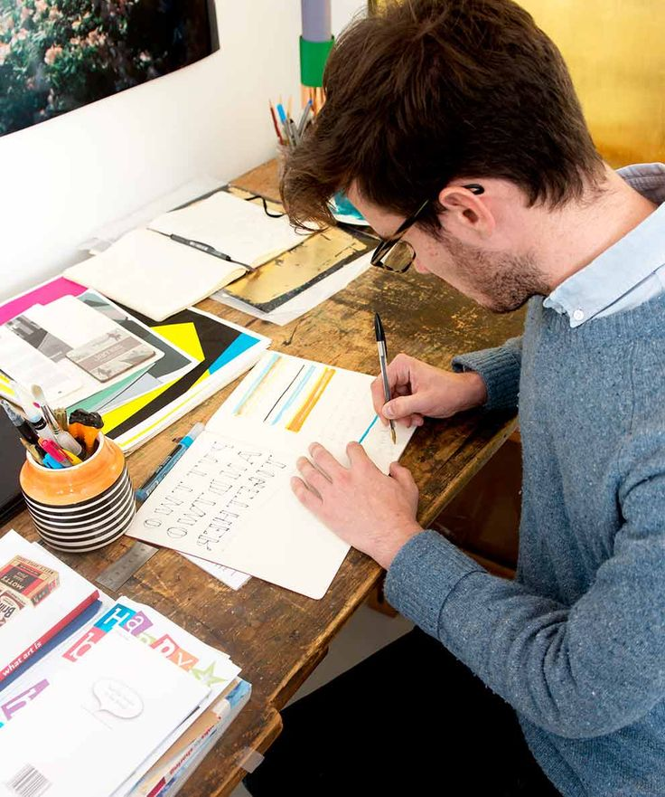 James working at his desk.