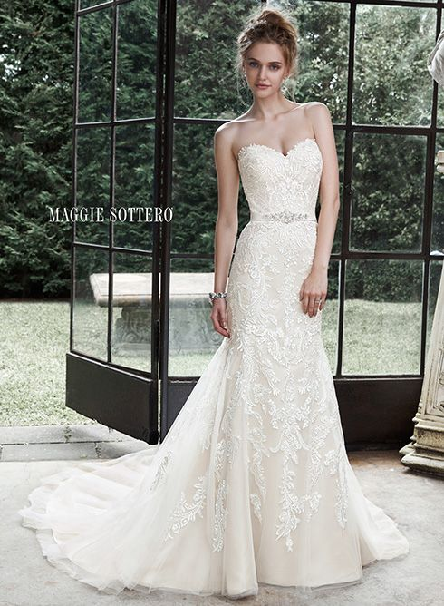 Lace and tulle fit and flare wedding dress with sweetheart neckline and Swarovski crystal belt. Winstyn by Maggie Sottero.