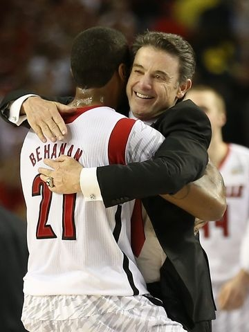 Louisville Coach Rick Pitino congratulates Chane Behanan after the Cardinals defeated Michigan 82-76 to win the NCAA Championship.