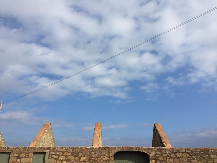 The blues sky over Crail and the top of the old cart sheds