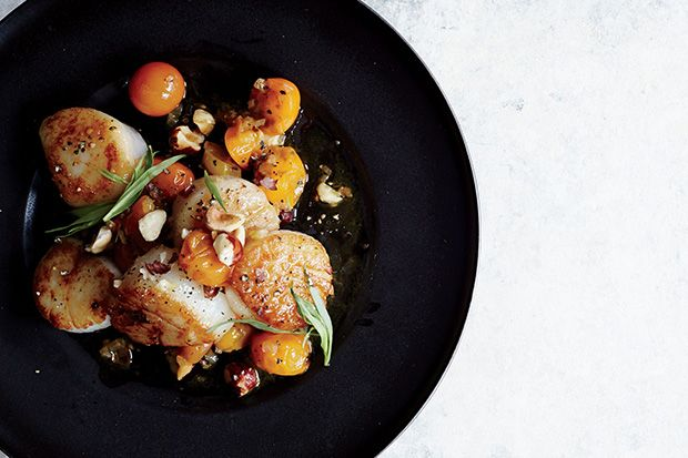 Find the recipe for Scallops with Hazelnuts and Warm Sun Gold Tomatoes and other scallop recipes at Epicurious.com