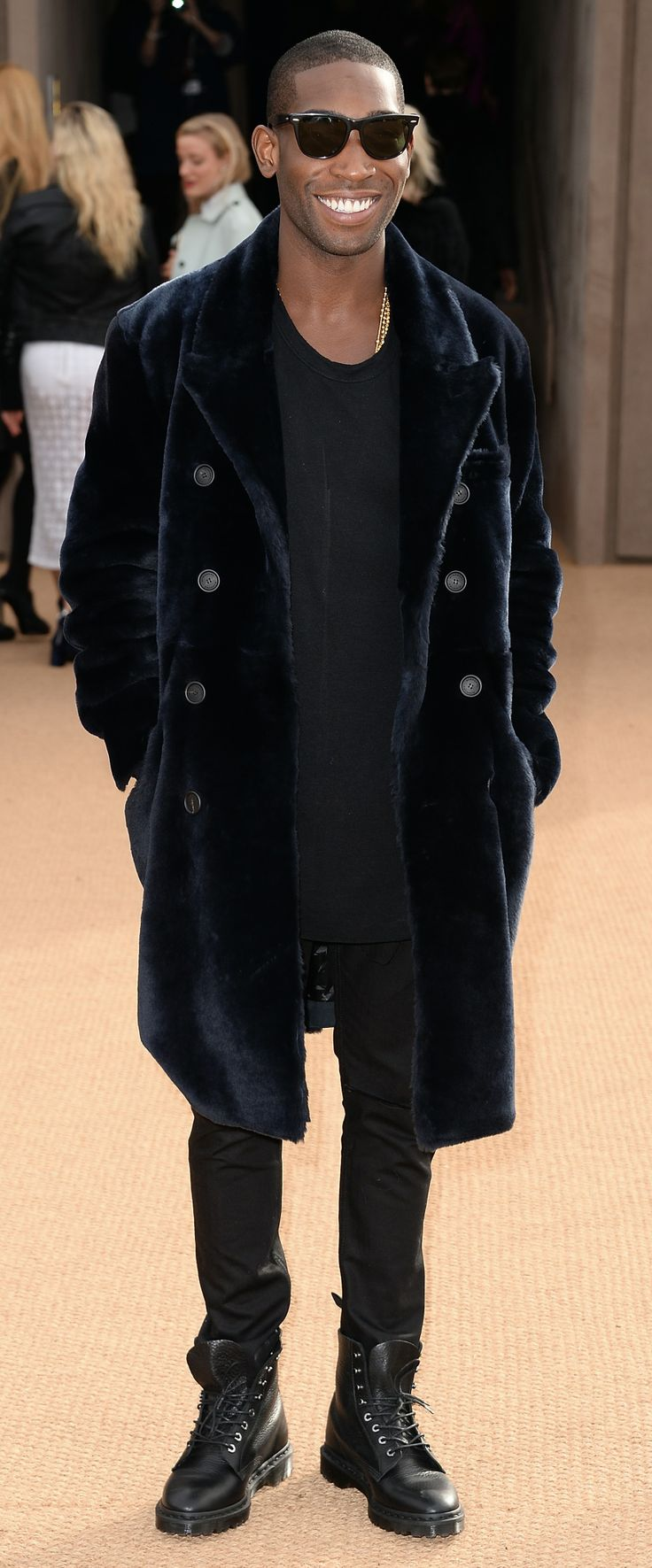 British musician Tinie Tempah wearing Burberry at the Burberry Prorsum Womenswear Autumn/Winter 2014 Show in London