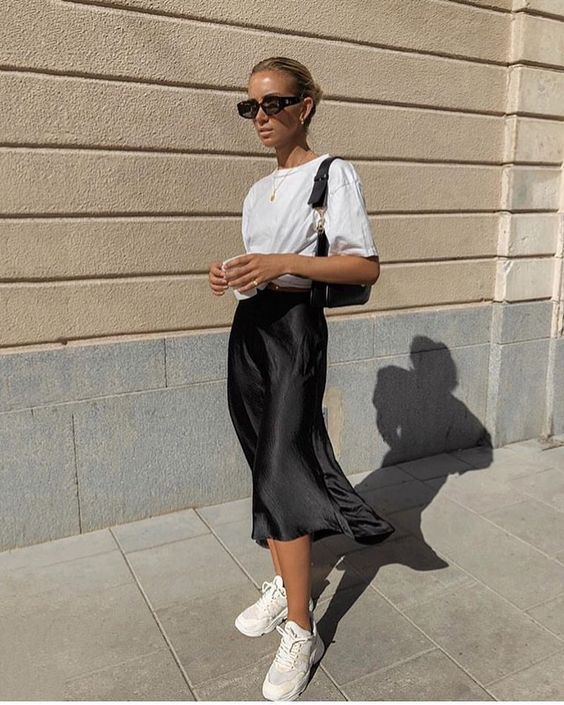 We really love how Lisa Olson styled her black silk slip skirt. We can't wai…
