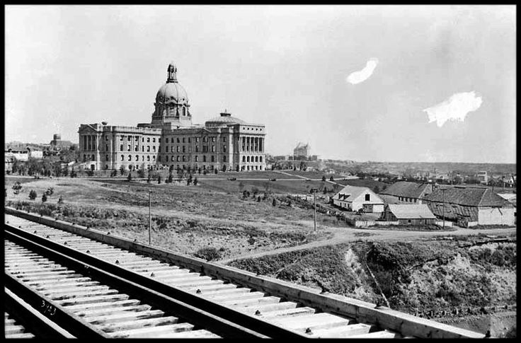 New Alberta Legislature building going up above the historical old Fort Edmonton before it was completely torn down. circa1910s