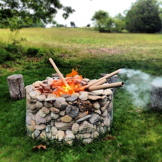 gabion fire pit I bet this burns like crazy. And warms up those rocks.