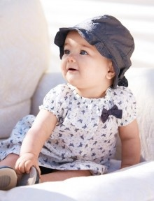 """In this image: Hat (6O2VB41DF); Dress (4CEW5V2IE); Shoes (8V4BT1129). Spring 2013 United Colors of Benetton Baby collection."""