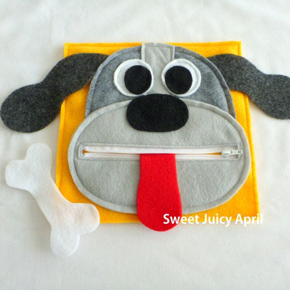 Dog zipper mouth page. Dog face with zipper mouth. Tongue is sewn inside mouth (not removable, but can be rolled/folded up to close the zipper). Dog bone can come out and be zipped back inside.  The ears of the dog extend beyond the page, so they stick outside the book.  Can be made in any color scheme.  All pages are made of felt and measure 8 x 8.  *All items made in smoke-free and pet-free environment.*  PLEASE NOTE: THIS PAGE CONTAINS SMALL PARTS THAT COULD BE A CHOKING HAZARD. NOT…
