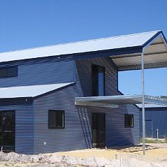 American barn showing horizontal cladding in corrugate and gable end balcony.