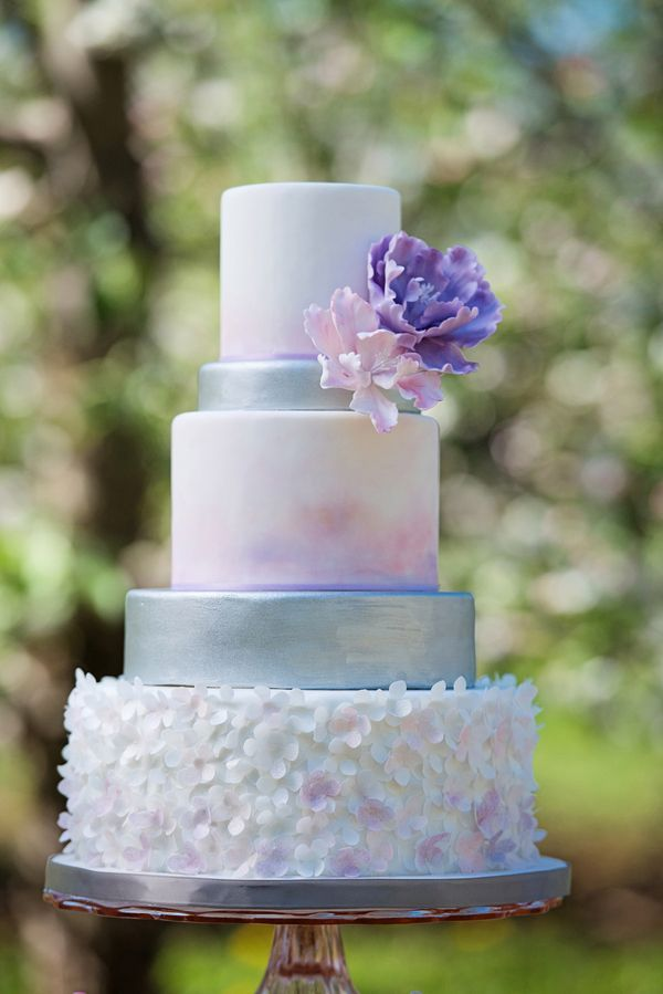 A five-tiered cake inspired by the soft colors of apple blossoms   Photo by This Is Photography   Cake by City Girl Cakes