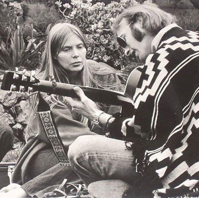 "Joni Mitchel with Stephen Stills at ""Celebration at Big Sur"", 1969."
