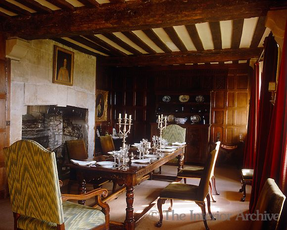 Mountain Cottage A Refectory Table Is Laid For Dinner Infront Of The Stone Fireplace In This Jacobean Panelled Dining Room