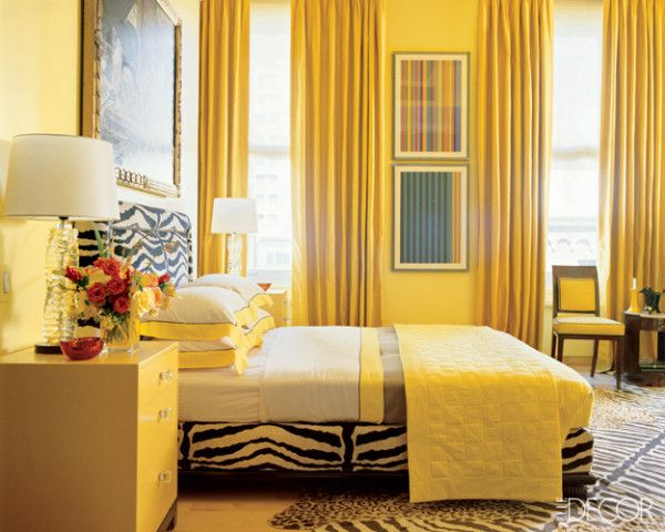 Jamie Drake did not hold back in this yellow dramatic bedroom with zebra bed and rug!