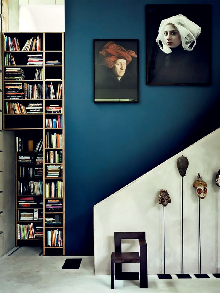 A striking blue wall highlights the line of the stairs.