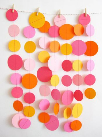 If the previous DIY decoration idea seemed too complicated or time consuming, then these circle garlands are an easier project. To make these, cut bits of cardboard or felt into circles and join them together by sewing a piece of string through them all. Hang them from the wall, ceiling