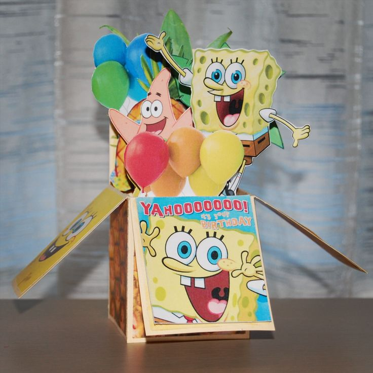 A birthday card in a box with Spongebob Squarepants and Patrick