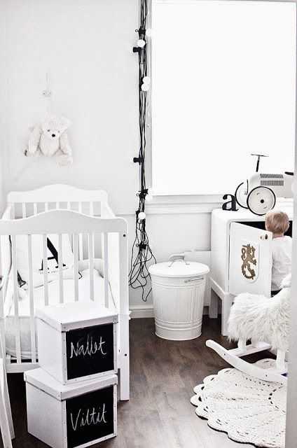 via the boo and the boy. All white and modern nursery. Cool chalkboard storage boxes