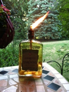Great idea!  Take an old liquor bottle and attach the wick from an old tiki torch.  Awesome ambiance.