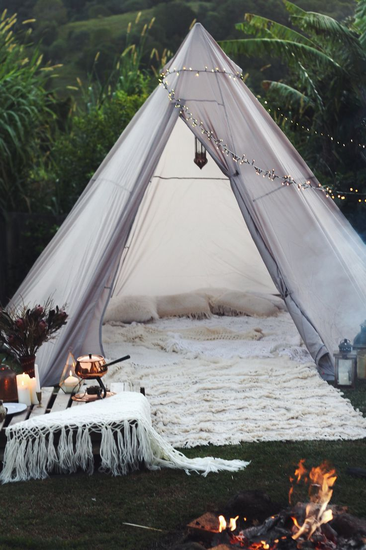 Glamping. Boho bohemian style camp out in the backyard. Moroccan wedding blanket, Kmart teepee tent. Camping in style!