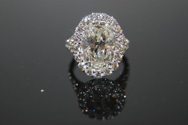 Google Image Result for http://www.wilkesjewels.com/files/modern_oval_diamond_ring.JPG