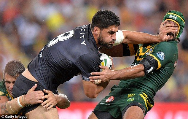Australia's Johnathan Thurston (right) takes a hand to the face from New Zealand's Jesse Bromwich
