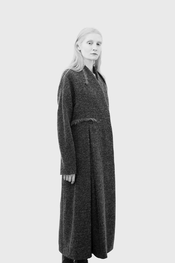 An interesting cut and proportion for a knitted coat. Not a 'usual' cardigan type garment. The overlapping almost shawl collar is an elegant neckline. The pleats add a sense of volume to the garment.  Damir Doma F/W 2015 Credit: style.com